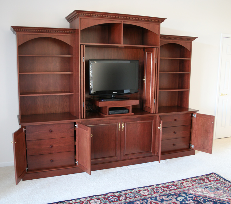 Custom bedroom built in entertainment center traditional design with arches for Bedroom entertainment center